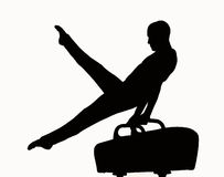 Gymnast silhouette. Silhouette of a man competing on pommel Royalty Free Stock Photo