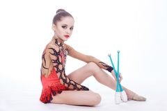 The gymnast sits on the floor Royalty Free Stock Photography