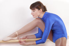 Gymnast stretches Royalty Free Stock Images