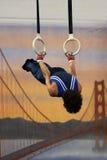 Gymnast sugli anelli Fotografie Stock