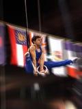 Gymnast sugli anelli immagini stock