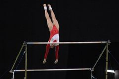 Gymnast uneven bars 01 stock images