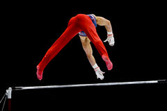 Gymnast on uneven bars Royalty Free Stock Images