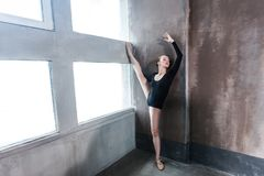 Gymnast woman doing aerobic exercise near window. Indoor shot royalty free stock image