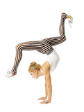 Gymnast woman flexible body standing on arms, training stretching, isolated white background royalty free stock image