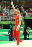 Gymnast You Hao of China competes at the Men`s Rings Final on artistic gymnastics competition at Rio 2016 Olympic Games. RIO DE JANEIRO, BRAZIL - AUGUST 15, 2016 Stock Photo