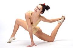 Gymnaste de jeune fille sur l'isolement blanc de fond sur le blanc photos libres de droits