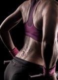 Gymnaste faisant des poids Photo stock