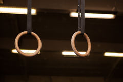 Gymnastic apparatus sport rings. On black background Stock Image
