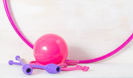 Gymnastic equipment. Skipping rope, clubs for rhythmic gymnastics, hoop and ball on white background Royalty Free Stock Image