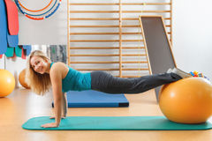 Gymnastic exercises on a gym ball. Royalty Free Stock Photos