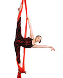 Gymnastic girl exercising on red fabric rope Stock Photo