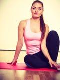 Gymnastic girl sitting on matress. Royalty Free Stock Photo