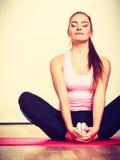 Gymnastic girl sitting on matress. Royalty Free Stock Image