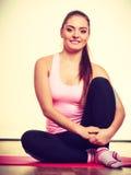 Gymnastic girl sitting on matress. Stock Images