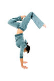 Gymnastic handstand. An isolated view of an agile gymnast doing a graceful handstand.  White background Stock Photography