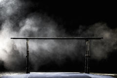 Gymnastic parallel bars.  on black background with fog, Stock Photos