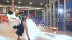 Gymnastic performance, company of girls perform dance on event in car sales center. Kherson, Ukraine 22 December 2017: gymnastic performance, company of girls stock video