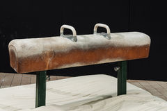 Gymnastic pommel horse. Close up against dark background and talc stains Royalty Free Stock Photography