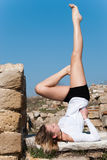 Gymnastic pose amongst ancient ruins in Avdira Royalty Free Stock Photos