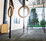 Gymnastic Rings Hanging in Cross Fitness Gym Stock Photos