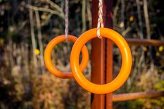 Gymnastic rings on the sports field for children royalty free stock images