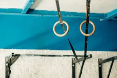 Gymnastic rings suspended on straps on crossfit gym Royalty Free Stock Images