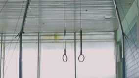 Gymnastic rings suspended to an iron arch, rings for training in the hall. Bottom view stock video footage