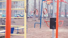 Gymnastic rings swing in the courtyard of the town house on the Playground. Gymnastic rings swing in the courtyard of the town house on the Playground stock video