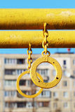 Gymnastic rings. Two yellow gymnastic rings at the playground outdoors Stock Photos