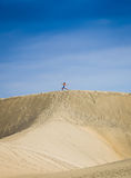 Gymnastic on the sand dunes Stock Photography