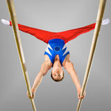 Gymnastics. The very strong sportsman of sports gymnastics Royalty Free Stock Image