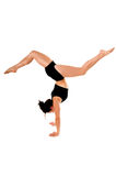 Gymnastics. A woman does a gymnastic handstand in the gym Stock Photography