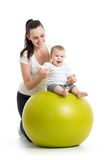 Gymnastics for baby on fitness ball Royalty Free Stock Photo
