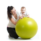 Gymnastics for baby  with fitness ball Royalty Free Stock Photography
