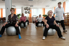 Gymnastics with ball for elders Royalty Free Stock Image