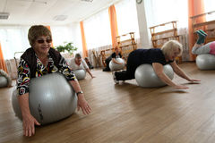 Gymnastics with ball for elders Stock Photography