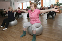 Gymnastics with ball for elders Stock Images
