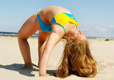 Gymnastics on the beach. Royalty Free Stock Photos