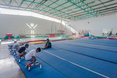 Gymnastics Boys Instructors Strengthening. Pinetown Gymnastics outside Durban South Africa is one of the best facilitated gyms in South Africa with equipment Royalty Free Stock Photography