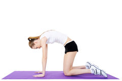 Gymnastics of female on the gymnastic carpet Royalty Free Stock Images