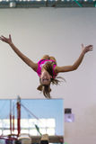 Gymnastics Girl Beam Somersaults Exit Royalty Free Stock Images