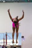 Gymnastics Girl Somersaults Beam Exit Royalty Free Stock Image