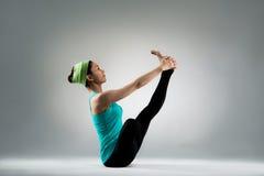 Gymnastics instructor actually show yoga posing Royalty Free Stock Photos