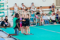 Gymnastics Instructor Young Girls Royalty Free Stock Photography