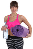 Gymnastics mat fitness woman water bottle at sports workout trai Royalty Free Stock Images