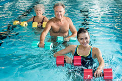 Gymnastics physiotherapy with dumbbells Stock Photo
