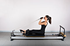 Gymnastics pilates. Bicep reformer position. Pilates gymnastics is a Germanic evolution of yoga, used by athletes to improve flexibility and body fitness and by Stock Photos