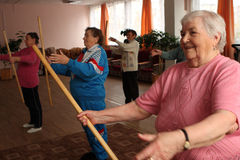 Gymnastics with sticks for eldery Stock Photography