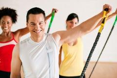 Gymnastics  training in gym Stock Photo